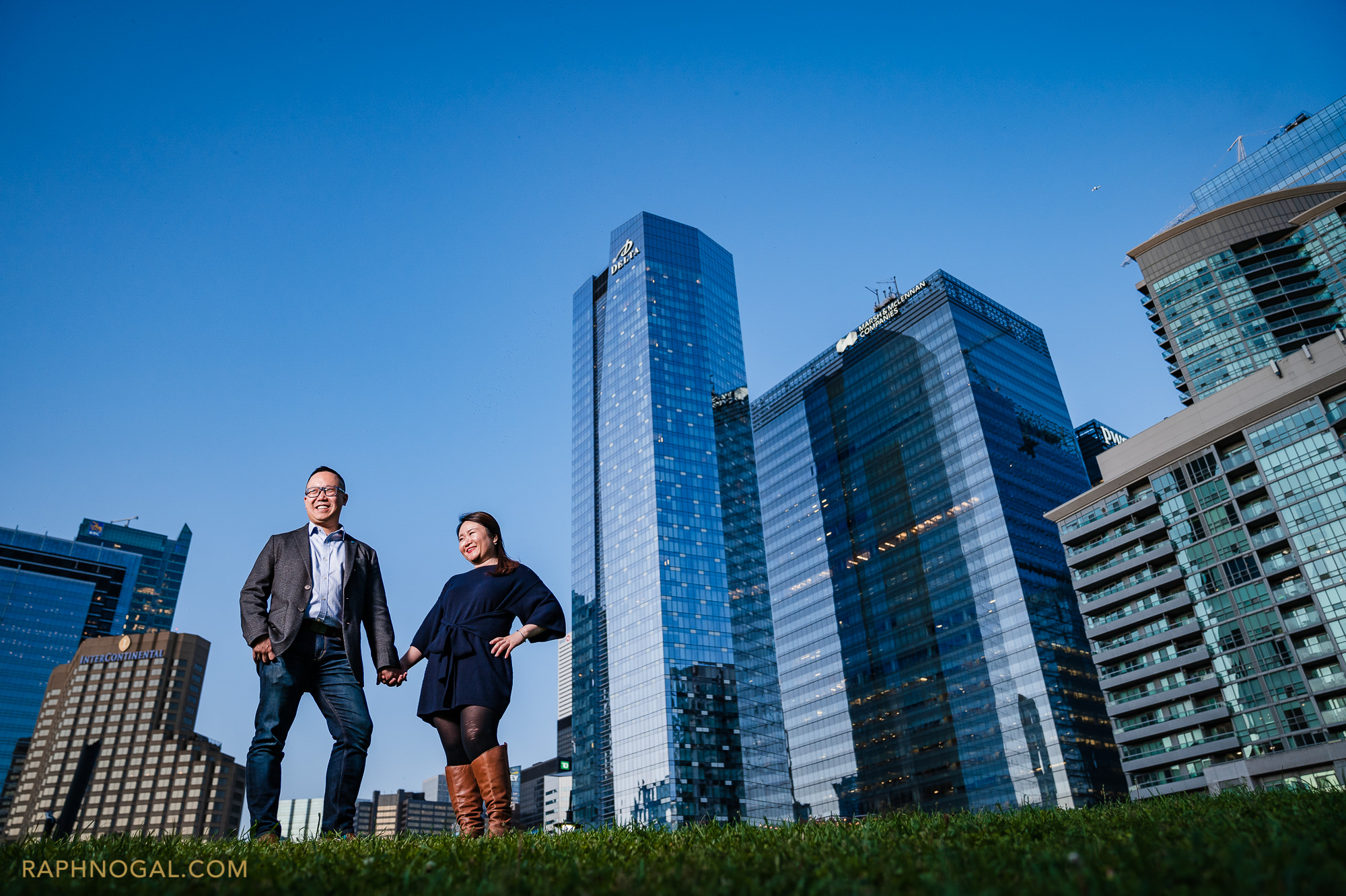 couple in front of downtown buildings