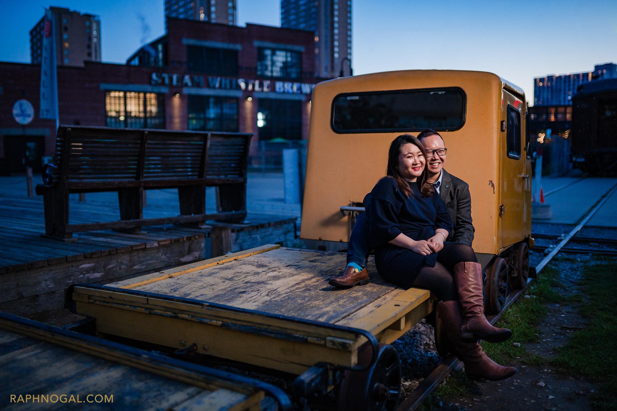couple sitting on yellow truck