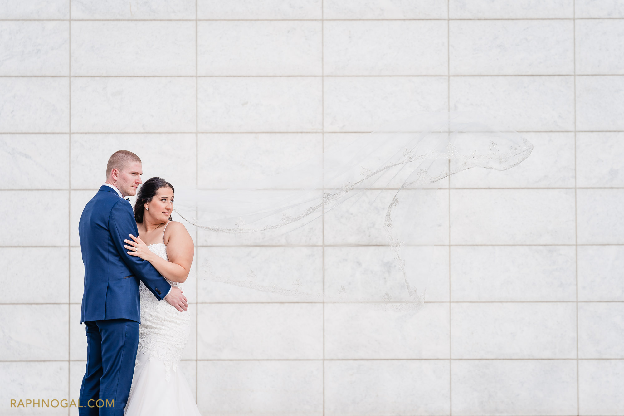 Bride and Groom at Aga Khan Museum and veil flies in the wind