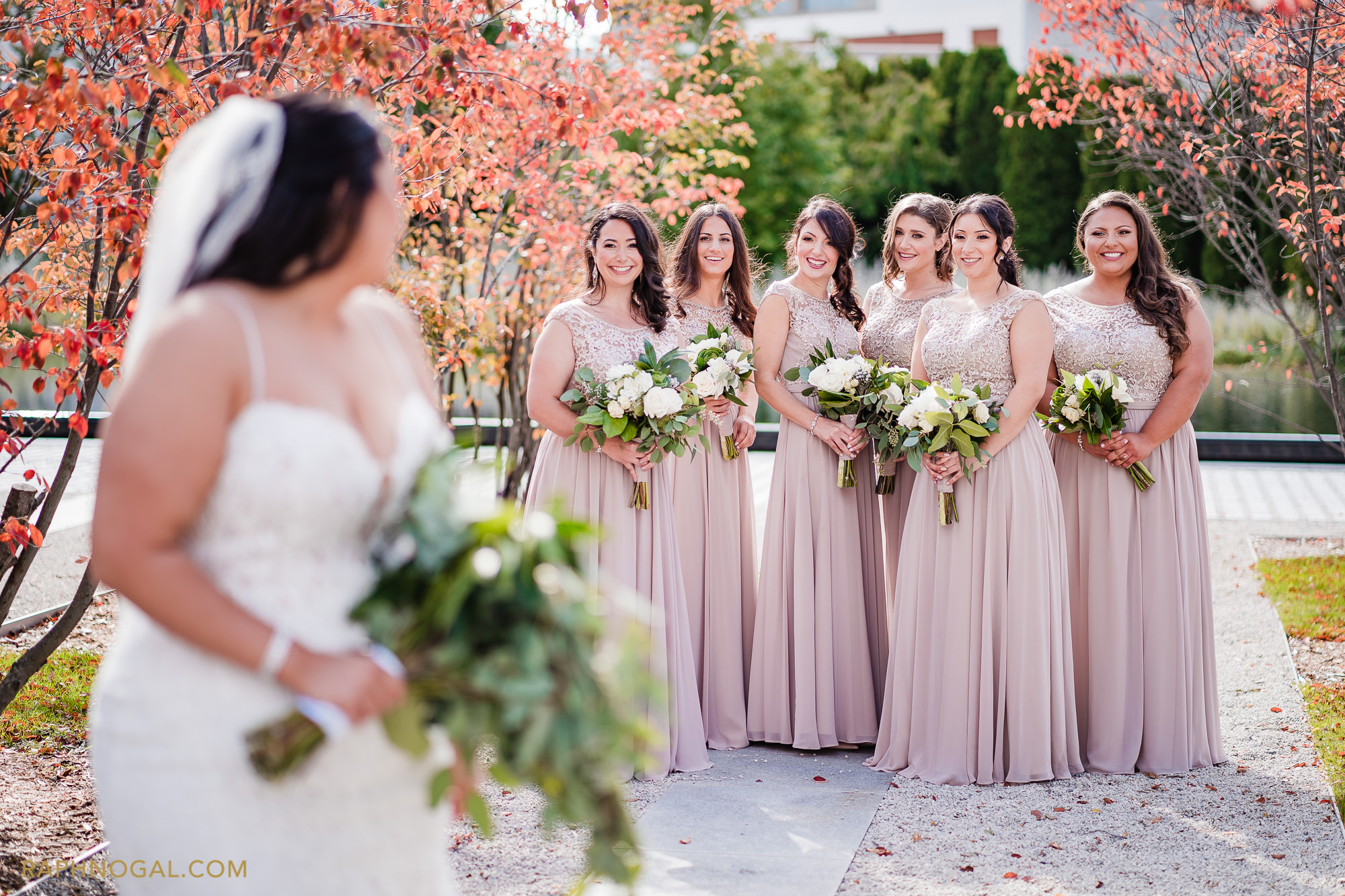 Bridesmaid smiling at Bride and she turn to them