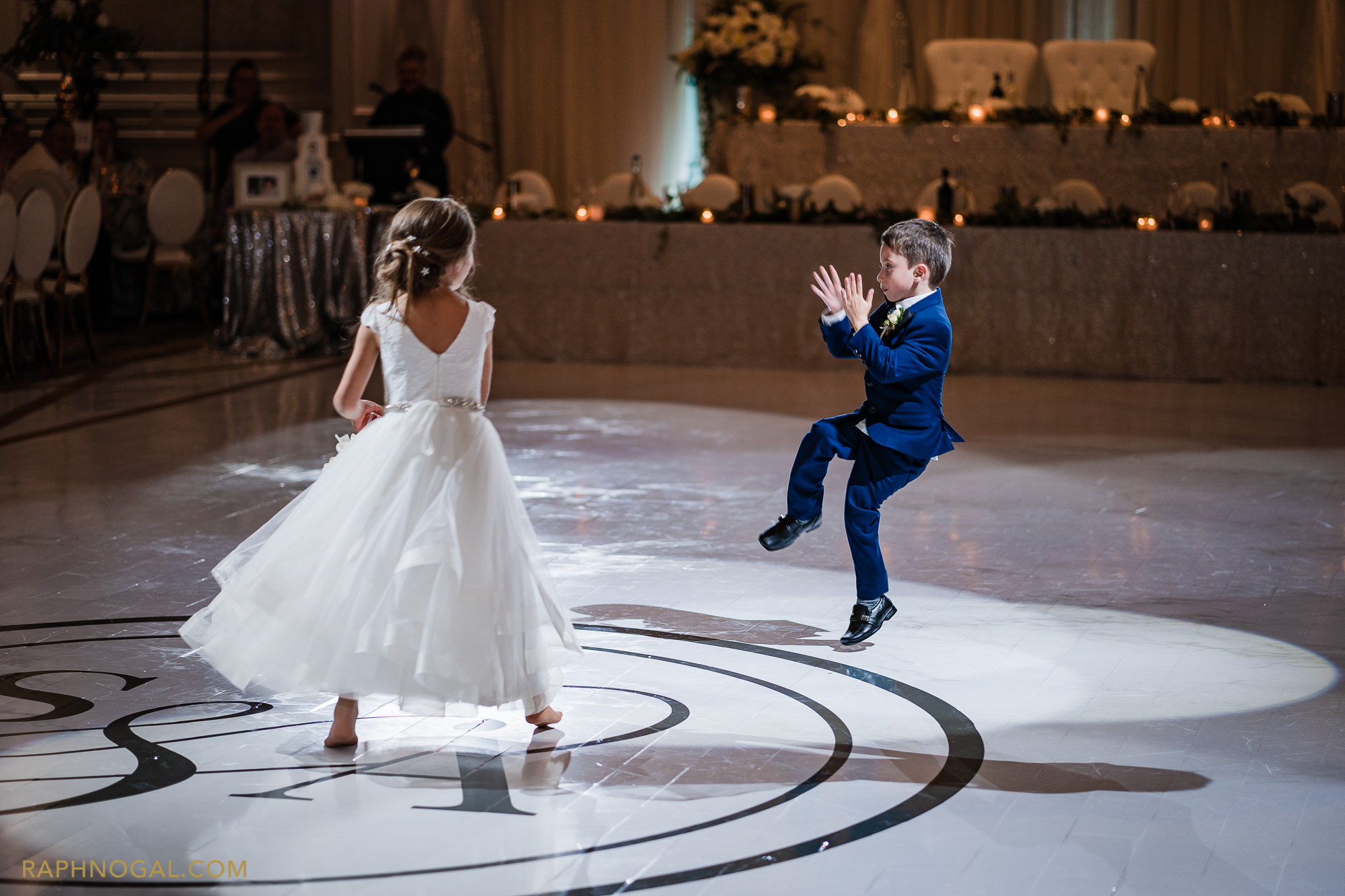 Ring boy and flower girl dance on the dance floor at Hazelton Manor
