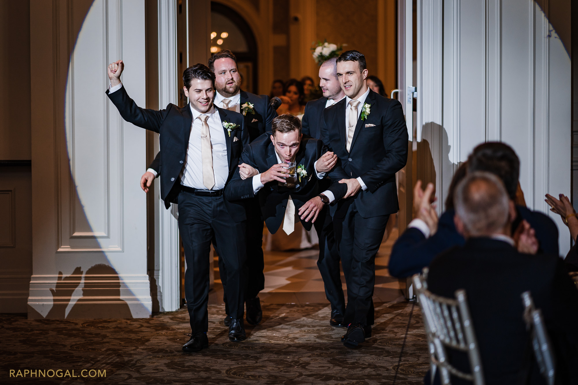 Groomsmen comedic reception entrance at Hazelton Manor