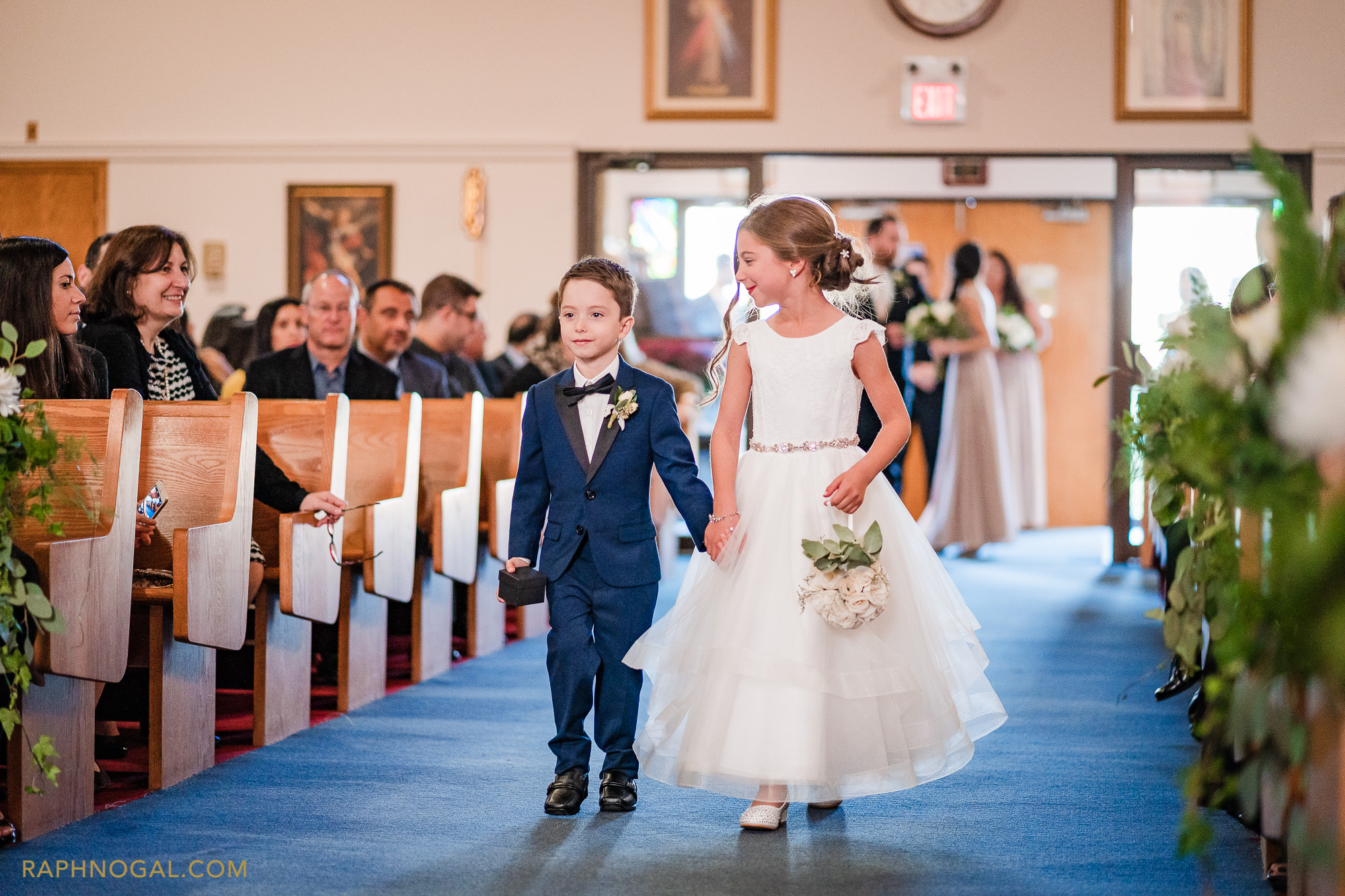 Ringboy and flowergirl walking down the isle